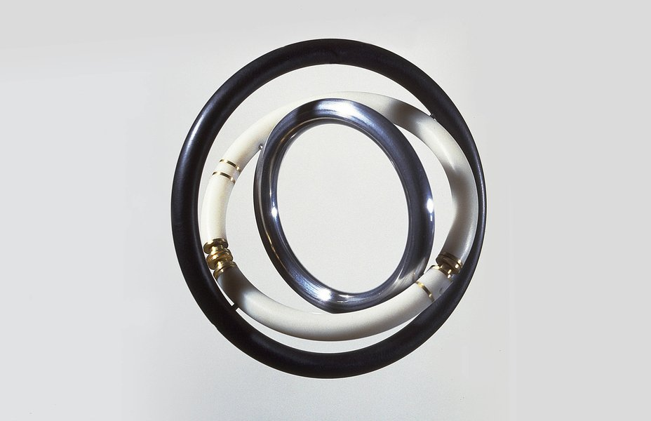 'Gyro' Bracelet, 1976, by David Watkins. 18ct gold, aluminium and Perspex.