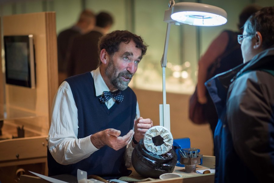Michael Lloyd demonstrating silversmithing at the National Museum of Scotland as part of the company's exhibition 'The Silversmith's Art' in 2015.