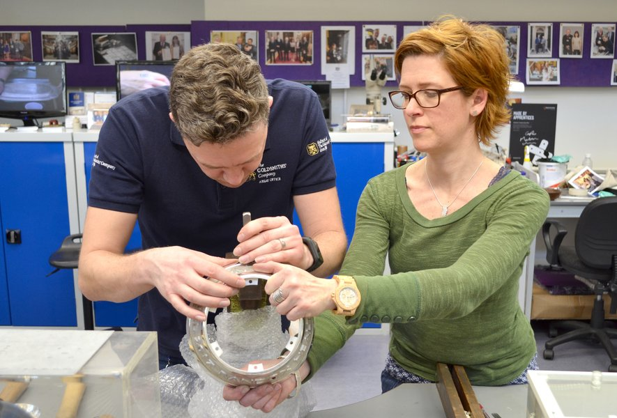 Adam Phillips hallmarking the base of the Trophy with silversmith Shannon O'Neill