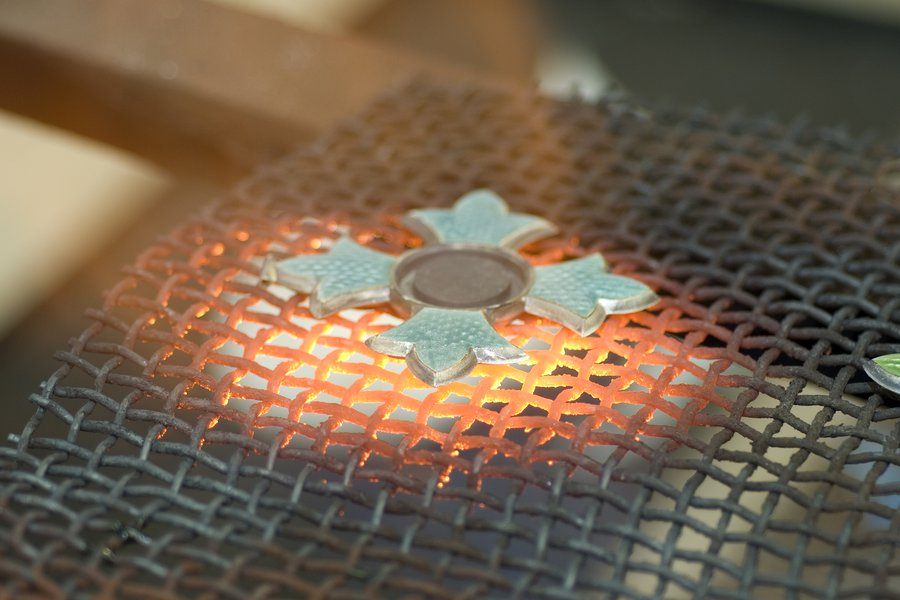 The enamelling process of a CBE medal. Image: Toye & Co