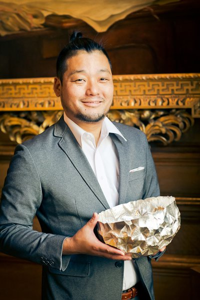 Silversmith Yusuke Yamamoto with his bowl, purchased for the Goldsmiths' Company Collection at the Fair in 2018. Photograph by Paul Read.