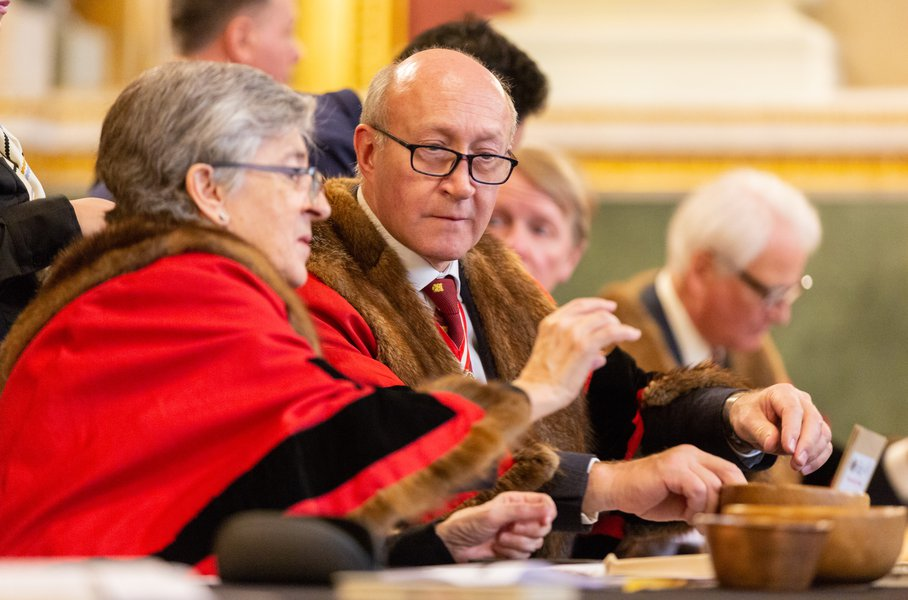 Wardens Dame Lynne Brindley and Richard Fox examine a commemorative coin at the Trial of the Pyx 2019