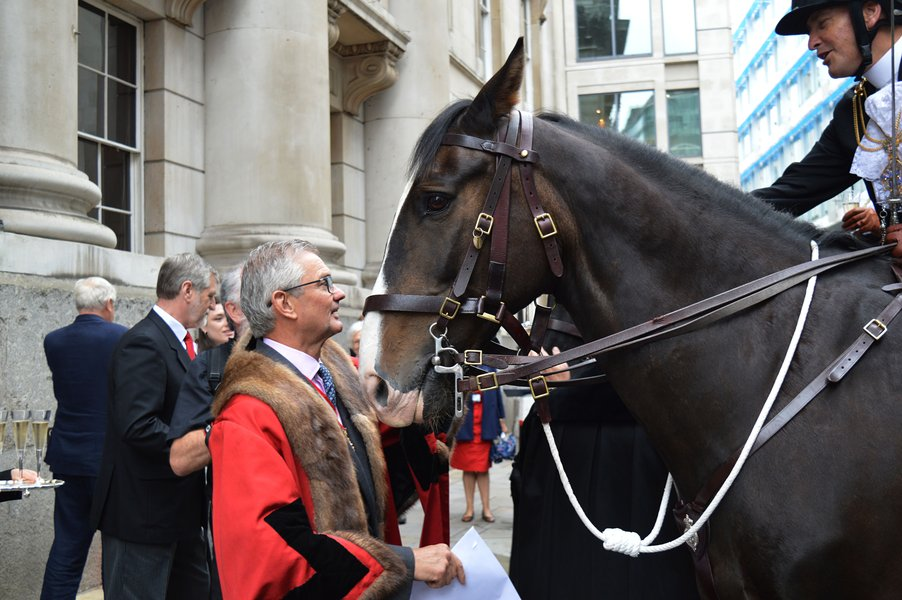 The Prime Warden Michael Wainwright with the horses of the Honourable Artillery Company
