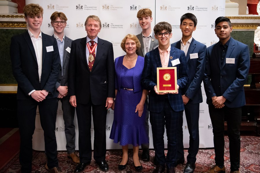 Prime Warden, Dr Timothy Schroder and Judith Cobham-Lowe, OBE with the Winners of the Goldsmiths' Awards for Community Engagement, Manchester Grammar School