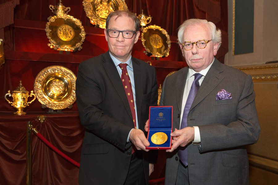 Thomas Fattorini presenting David Starkey with a medal