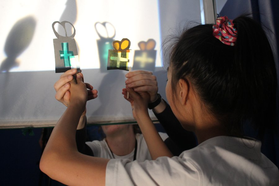 Students making shadow puppet films inspired by the Museum of London and its collections. Photographer: Shanta Amdurer